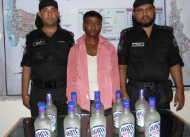 rab held alcohol trader in sherpur