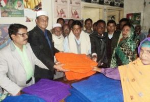 Dhanbari-cloth distribution among poor